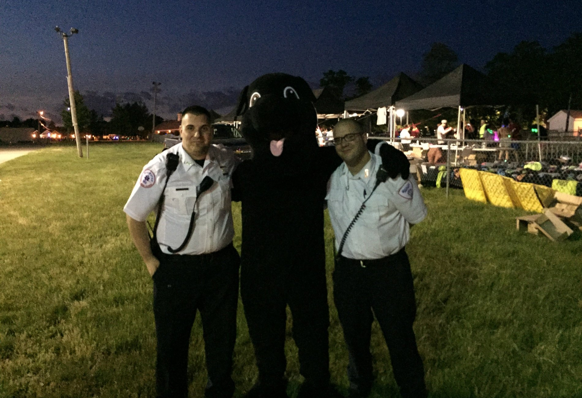 Blackie the Dog from Casey Movers with some EMTs at Boston Night Run 2015